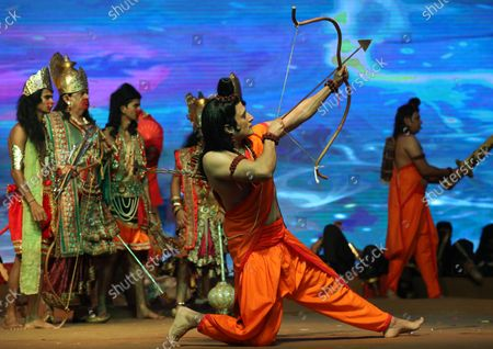 An Indian artist dressed as Hindu god Lord Ram (C) along with others perform in the 'Lord Rama's annual traditional play called Ramleela during the Dussehra festival celebrations in New Delhi, India, 15 October 2021. Limited people were allowed inside the Dussehra festival celebration area due to Indian government guidelines over the Covid-19 pandemic. Dussehra is an annual Hindu religious festival, which follows the nine-day festival of Navratri and marks the victory of the Hindu God Lord Rama over the evil demon king Ravana.