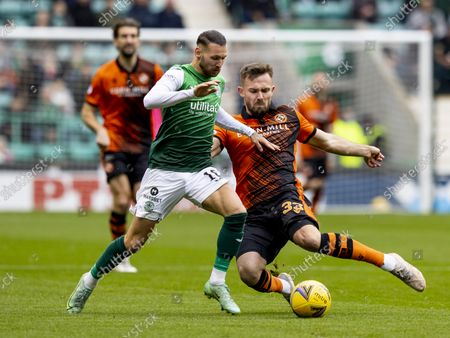 Martin Boyle of Hibernian and Scott McMann of Dundee United compete for possession of the ball; Easter Road, Edinburgh, Scotland; Scottish Premier League football, Hibernian versus Dundee United.