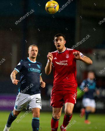 Declan Gallagher of Aberdeen wins the header from Leigh Griffiths of Dundee; Dens Park, Dundee, Scotland; Scottish Premier League football, Dundee FC versus Aberdeen.