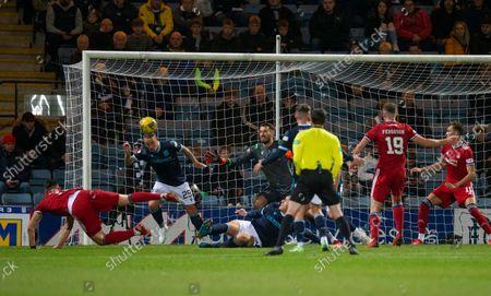 Leigh Griffiths of Dundee heads away an effort from Ryan Hedges of Aberdeen from the goal line; Dens Park, Dundee, Scotland; Scottish Premier League football, Dundee FC versus Aberdeen.