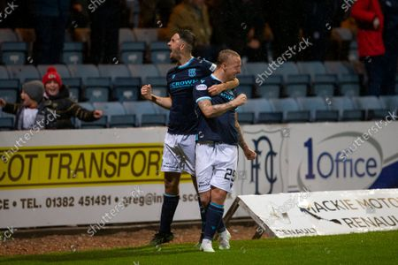 Leigh Griffiths of Dundee is congratulated after scoring for 1-0 by Shaun Byrne in 49th minute; Dens Park, Dundee, Scotland; Scottish Premier League football, Dundee FC versus Aberdeen.
