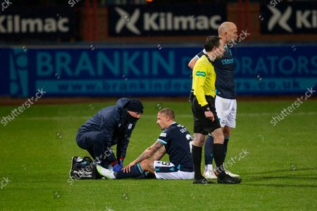 Leigh Griffiths of Dundee gets treatment from physio Gerry Docherty; Dens Park, Dundee, Scotland; Scottish Premier League football, Dundee FC versus Aberdeen.