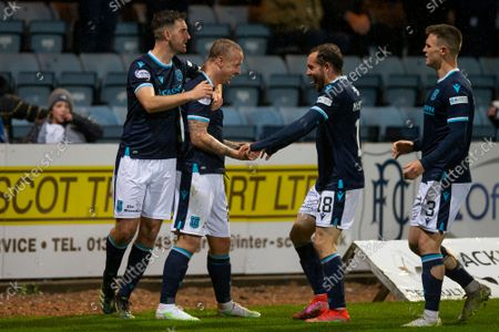 Leigh Griffiths of Dundee is congratulated after scoring in 49th minute for 1-0 by Shaun Byrne, Paul McMullan and Jordan Marshall; Dens Park, Dundee, Scotland; Scottish Premier League football, Dundee FC versus Aberdeen.