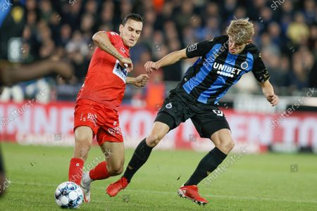 Kortrijk's Trent Sainsbury and Club's Charles De Ketelaere fight for the ball during a soccer match between Club Brugge and KV Kortrijk, Friday 15 October 2021 in Brugge, on day 11 of the 2021-2022 'Jupiler Pro League' first division of the Belgian championship.