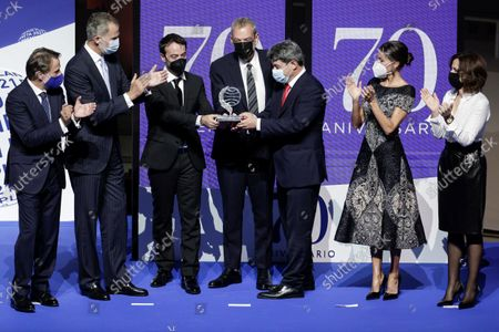 Stock Photo of Spain's King Felipe VI (2L) and Queen Letizia (2R) give the Planeta literary award to the writers Agustin Martinez (3L), Jorge Diaz (C) and Antonio Mercero (3R) for their novel 'La bestia' (The Beast) during the 70th Planeta Prize ceremony in Barcelona, Spain, 15 October 2021. Jose Creuheras, the president of Grupo Planeta, announced on 14 October 2021 that the Planeta Prize's endowment would almost double and increase to one million euros on the occasion of the Premio Planeta de Novela's 70th edition, making it the best-endowed literary award in the world.