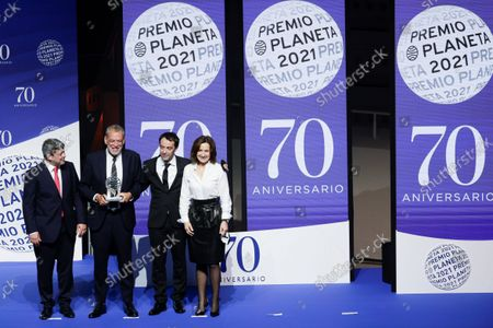 Spanish writers (L-R) Agustin Martinez, Jorge Diaz and Antonio Mercero pose after receiving the Planeta literary award for their novel 'La bestia' (The Beast), accompanied by Spanish writer Paloma Sanchez Garnica (R) winner of the second prize for her novel 'Ultimos dias en Berlin' (Last days in Berlin), during the 70th Planeta Literary Award ceremony in Barcelona, Spain, 15 October 2021. Jose Creuheras, the president of Grupo Planeta, announced on 14 October 2021 that the Planeta Prize's endowment would almost double and increase to one million euros on the occasion of the Premio Planeta de Novela's 70th edition, making it the best-endowed literary award in the world.