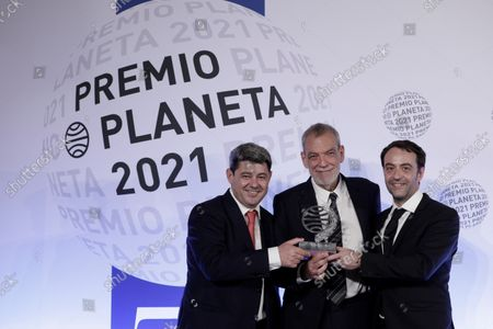 Spanish writers (L-R) Agustin Martinez, Jorge Diaz and Antonio Mercero pose with the prize after receiving the Planeta literary award for their novel 'La Bestia' (The Beast), during the 70th Planeta Literary Award ceremony in Barcelona, Spain, 15 October 2021.