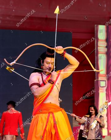 An artist dressed as Lord Rama with a bow and arrow performs, during the festival. Hindu festival of Dussehra at Lav Kush Ramlila. The 10 days are also known as Vijaydashami celebration, at the end of Navratri every year. The day marks Lord Ram's defeat over the evil king of the demon Ravana.