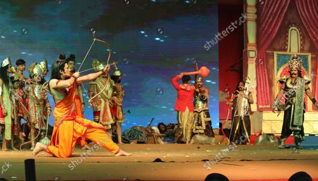 An artist dressed as Lord Ram enact Ram-Ravana yudh during the festival. Hindu festival of Dussehra at Lav Kush Ramlila. The 10 days are also known as Vijaydashami celebration, at the end of Navratri every year. The day marks Lord Ram's defeat over the evil king of the demon Ravana.