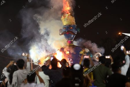 Stock Image of People watch the burning of an effigy of demon Kumbhakarna, during the festival. Hindu festival of Dussehra at Lav Kush Ramlila. The 10 days are also known as Vijaydashami celebration, at the end of Navratri every year. The day marks Lord Ram's defeat over the evil king of the demon Ravana.