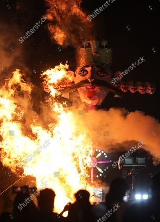 Stock Photo of People watch the burning of an effigy of demon Ravana during the festival. Hindu festival of Dussehra at Lav Kush Ramlila. The 10 days are also known as Vijaydashami celebration, at the end of Navratri every year. The day marks Lord Ram's defeat over the evil king of the demon Ravana.