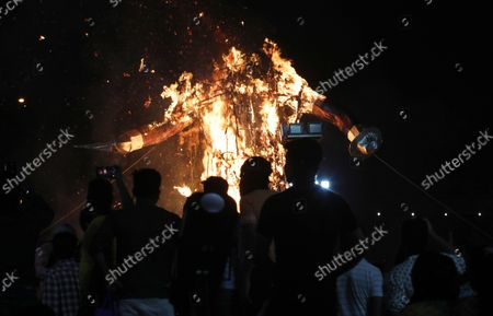 People watch the burning of an effigy of demon Ravana during the festival. Hindu festival of Dussehra at Lav Kush Ramlila. The 10 days are also known as Vijaydashami celebration, at the end of Navratri every year. The day marks Lord Ram's defeat over the evil king of the demon Ravana.