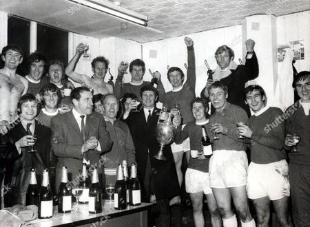 Brian Labone (died 4/06) Everton And England Footballer (in Coat Holding Trophy With Alan Ball) With The Everton Team In The Dressing Room After They Won The Ist Division Championship In The 1969/70 Season. Back Row (l-r)howard Kendall Colin Harvey Alan Whittle Sandy Brown Joe Royle John Morrissey Keith Newton. Front Row (l-r) Joe Harper Roger Kenyon Manager Harry Catterick His Assistant Wilf Dixon Jimmy Husband (hidden) Brian Labone Alan Ball Gordon West John Hurst And Andy Rankin.