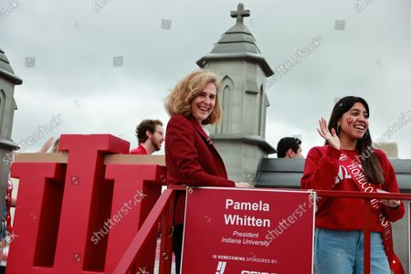 Indiana University President Pamela Whitten, left, rides on a float during the Indiana University Homecoming Parade.Student Groups participate in the Indiana University (IU) Homecoming Parade. The parade began on 17th Street and Woodlawn.