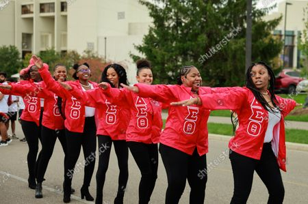 Members of Delta Sigma Theta sorority dance during the Indiana University Homecoming Parade.Student Groups participate in the Indiana University (IU) Homecoming Parade. The parade began on 17th Street and Woodlawn.