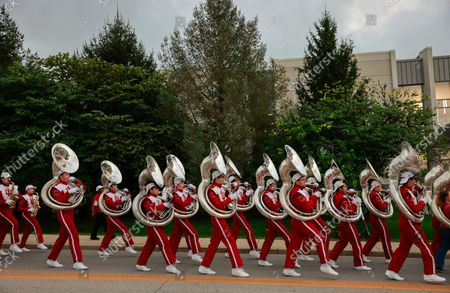 Members of the Indiana University Marching Hundred march during the Indiana University Homecoming Parade.Student Groups participate in the Indiana University (IU) Homecoming Parade. The parade began on 17th Street and Woodlawn.