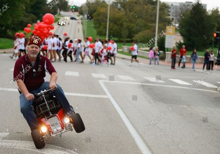A member of the Shriners rides sideways during the Indiana University Homecoming Parade.Student Groups participate in the Indiana University (IU) Homecoming Parade. The parade began on 17th Street and Woodlawn.