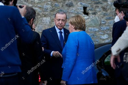 Turkey's President Recep Tayyip Erdogan, center, talks to German Chancellor Angela Merkel at the end of their meeting at Huber Villa presidential palace, in Istanbul, Turkey, . The leaders discussed Ankara's relationship with Germany and the European Union as well as regional issues including Syria and Afghanistan