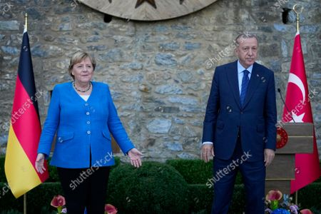 Turkey's President Recep Tayyip Erdogan, right, and German Chancellor Angela Merkel pose for the media at the end of a joint news conference following their meeting at Huber vila, Erdogan's presidential resident, in Istanbul, Turkey, . The leaders discussed Ankara's relationship with Germany and the European Union as well as regional issues including Syria and Afghanistan