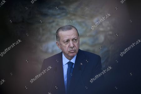 Turkey's President Recep Tayyip Erdogan listens to a question during a joint news conference with German Chancellor Angela Merkel following their meeting at Huber Villa presidential palace, in Istanbul, Turkey, . The leaders discussed Ankara's relationship with Germany and the European Union as well as regional issues including Syria and Afghanistan