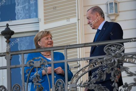 Turkey's President Recep Tayyip Erdogan, right, talks to German Chancellor Angela Merkel during their meeting at Huber Villa presidential palace, in Istanbul, Turkey, . The leaders discussed Ankara's relationship with Germany and the European Union as well as regional issues including Syria and Afghanistan