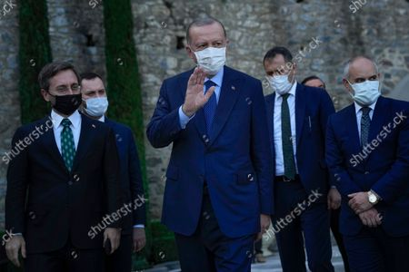 Turkey's President Recep Tayyip Erdogan, center, gestures to the media as he leaves after his meeting with German Chancellor Angela Merkel at Huber Villa presidential palace, in Istanbul, Turkey, . The leaders discussed Ankara's relationship with Germany and the European Union as well as regional issues including Syria and Afghanistan