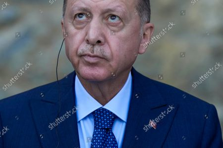 Turkey's President Recep Tayyip Erdogan looks up during a joint news conference with German Chancellor Angela Merkel following their meeting at Huber Villa presidential palace, in Istanbul, Turkey, . The leaders discussed Ankara's relationship with Germany and the European Union as well as regional issues including Syria and Afghanistan