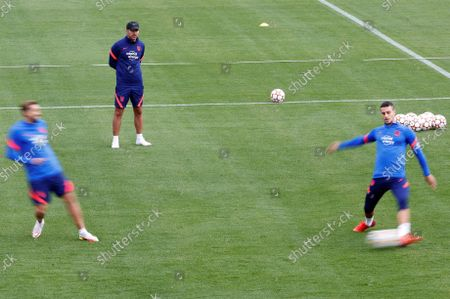 Atletico Madrid's head coach, Diego Simeone (C), and Spanish defender Mario Hermoso (R) during the team's training session held at Wanda Sports city in Majadahonda, Madrid, Spain, 16 October 2021.