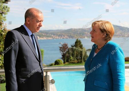 Turkish President Recep Tayyip Erdogan, left, and German Chancellor Angela Merkel talks to each otherat Huber Villa presidential palace ahead of their meeting, in Istanbul, . Merkel and Erdogan are expected to discuss Ankara's relationship with Germany and the European Union as well as regional issues including Syria and Afghanistan. The chancellor's trip is one of her last before she leaves her position