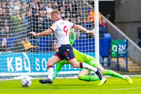 Wigan Athletic goalkeeper Ben Amos (12)makes a save during the EFL Sky Bet League 1 match between Bolton Wanderers and Wigan Athletic at the University of  Bolton Stadium, Bolton