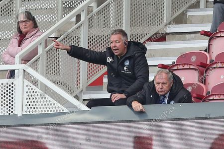Peterborough United Manager Darren Ferguson shouts instructions from the stands after being handed a touchline ban for the match against Middlesbrough