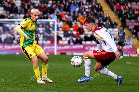 Luke Thomas of Bristol Rovers gets the ball past Matty Foulds of Bradford City