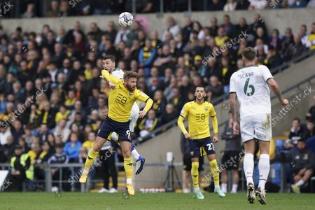 Plymouth Argyle defender James Wilson heads the ball under pressure from Oxford United forward Matty Taylor during the EFL Sky Bet League 1 match between Oxford United and Plymouth Argyle at the Kassam Stadium, Oxford