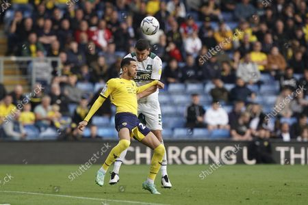 Plymouth Argyle defender James Wilson heads the ball during the EFL Sky Bet League 1 match between Oxford United and Plymouth Argyle at the Kassam Stadium, Oxford