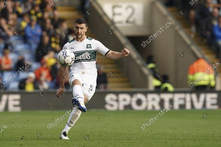 Stock Photo of Plymouth Argyle defender James Wilson passes during the EFL Sky Bet League 1 match between Oxford United and Plymouth Argyle at the Kassam Stadium, Oxford