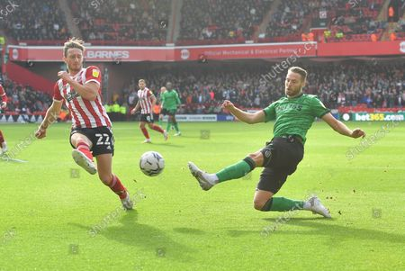 Stoke City midfielder Nick Powell  (25)  and Sheffield United defender Ben Davies  (22) during the EFL Sky Bet Championship match between Sheffield United and Stoke City at Bramall Lane, Sheffield