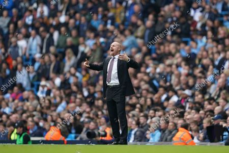 Burnley's manager Sean Dyche gives instructions from the side line during the English Premier League soccer match between Manchester City and Burnley at Etihad stadium in Manchester, England