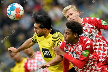 Dortmund's Emre Can (L) in action against Mainz' Jean-Paul Boetius (R) during the German Bundesliga soccer match between Borussia Dortmund and 1. FSV Mainz 05 at Signal Iduna Park in Dortmund, Germany, 16 October 2021.