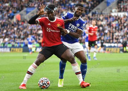 Kelechi Iheanacho (R) of Leicester in action against Paul Pogba (L) of Manchester United during the English Premier League match between Leicester City and Manchester United in Leicester, Britain, 16 October 2021.
