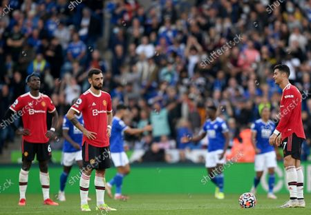 Paul Pogba (L), Bruno Fernandes (C) and Cristiano Ronaldo (R) of of Manchester United react after conceding a goal during the English Premier League match between Leicester City and Manchester United in Leicester, Britain, 16 October 2021.
