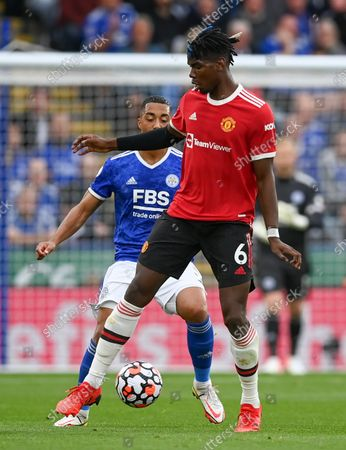 Paul Pogba (front) of Manchester United in action during the English Premier League match between Leicester City and Manchester United in Leicester, Britain, 16 October 2021.