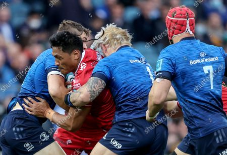 Leinster vs Scarlets. Scarlets' Sam Lousi is tackled by Garry Ringrose and Andrew Porter of Leinster
