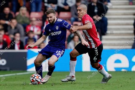 Stock Picture of Leeds United's Stuart Dallas, left, controls the ball while Southampton's Oriol Romeu attempts to win it back during an English Premier League soccer match at St. Mary's Stadium in Southampton, England