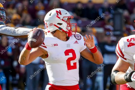 Nebraska quarterback Adrian Martinez (2) passes under pressure from Minnesota during the first quarter of an NCAA college football game, in Minneapolis