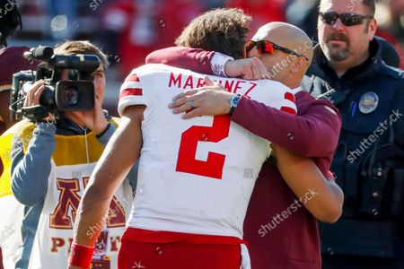 Minnesota head coach P.J. Fleck, right, hugs and speaks to Nebraska quarterback Adrian Martinez (2) after an NCAA college football game, in Minneapolis. Minnesota won 30-23