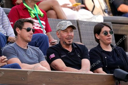 Former chief executive officer of Oracle, Larry Ellison, center, watches a semifinal match between Taylor Fritz, of the United States, and Nikoloz Basilashvili, of Georgia, at the BNP Paribas Open tennis tournament, in Indian Wells, Calif
