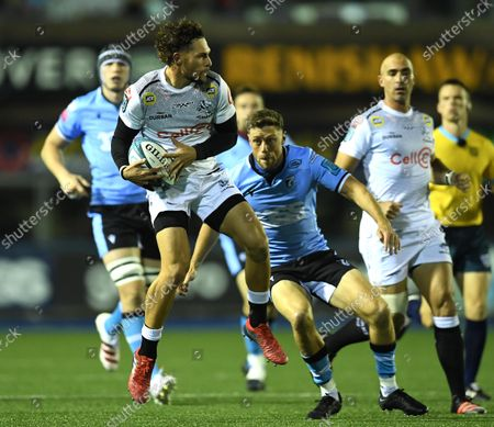 Stock Picture of Boeta Chamberlain of Sharks is tackled by Rhys Priestland of Cardiff.