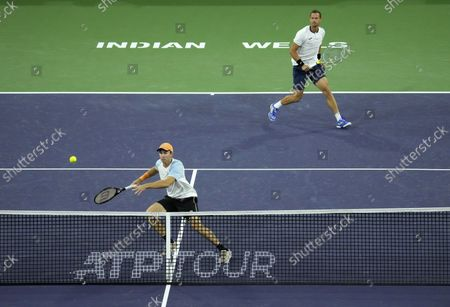 John Peers of Australia (B) and Filip Polasek of Slovakia (T) in action against Aslan Karatsev of Russia and Andrey Rublev of Russia during the men's doubles final at the BNP Paribas Open tennis tournament at the Indian Wells Tennis Garden in Indian Wells, California, USA, 16 October 2021.