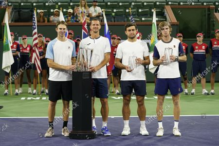 John Peers of Australia (L) and Filip Polasek of Slovakia (2L) celebrate with the trophy after defeating Aslan Karatsev of Russia (2R) and Andrey Rublev of Russia (R) in the men's doubles final at the BNP Paribas Open tennis tournament at the Indian Wells Tennis Garden in Indian Wells, California, USA, 16 October 2021.