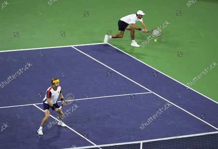 Aslan Karatsev of Russia (R) and Andrey Rublev of Russia (L) in action against John Peers of Australia and Filip Polasek of Slovakia during the men's doubles final at the BNP Paribas Open tennis tournament at the Indian Wells Tennis Garden in Indian Wells, California, USA, 16 October 2021.